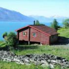 Cottage with nice view on the Hardangerfjord and the mountains, including motorboat, Sauna, included electricity.