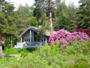 Holiday home with motorboat for hire at the Hardanger, internet, TV, Sauna, incl. electricity.