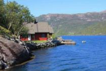 Very nice norwegian summerhouse direct at the Fjord, including motorboat, including TV and internet, including current, best view on the water!